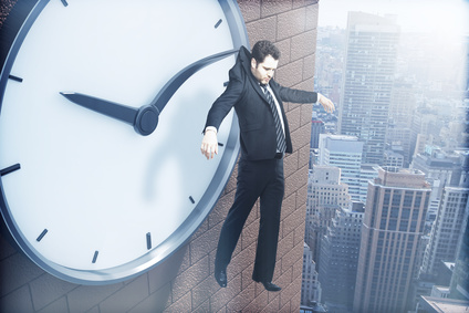 Time management concept with businessman hanging on clock arrow above city. 3D Rendering