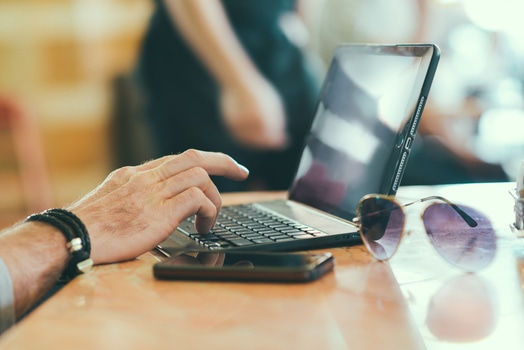 sunglasses-hand-smartphone-desk-medium