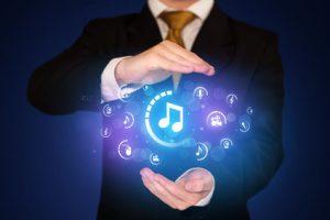 Businessman holding digital multimedia icons